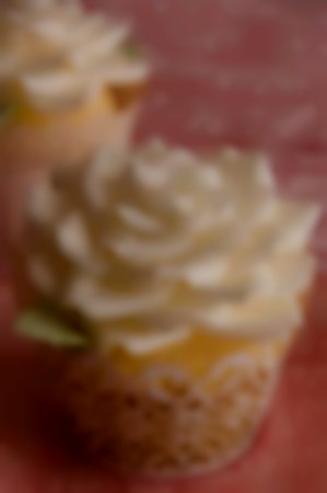 Wedding cupcakes with intricate sugar rose toppers