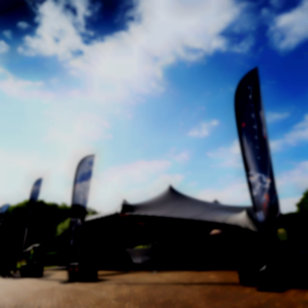 Black Stretch Tent blue sky by intent productions ltd