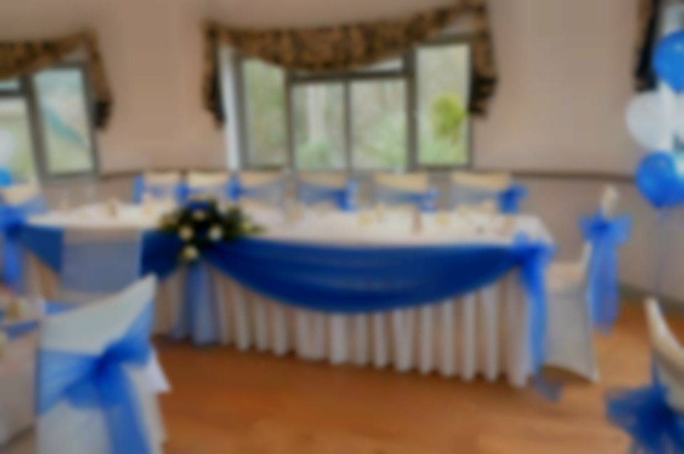 Ivory Stretch Chair Covers + Royal Blue Organza Sash