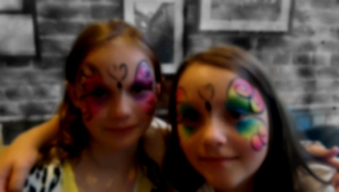 two beautiful face painted butterflies