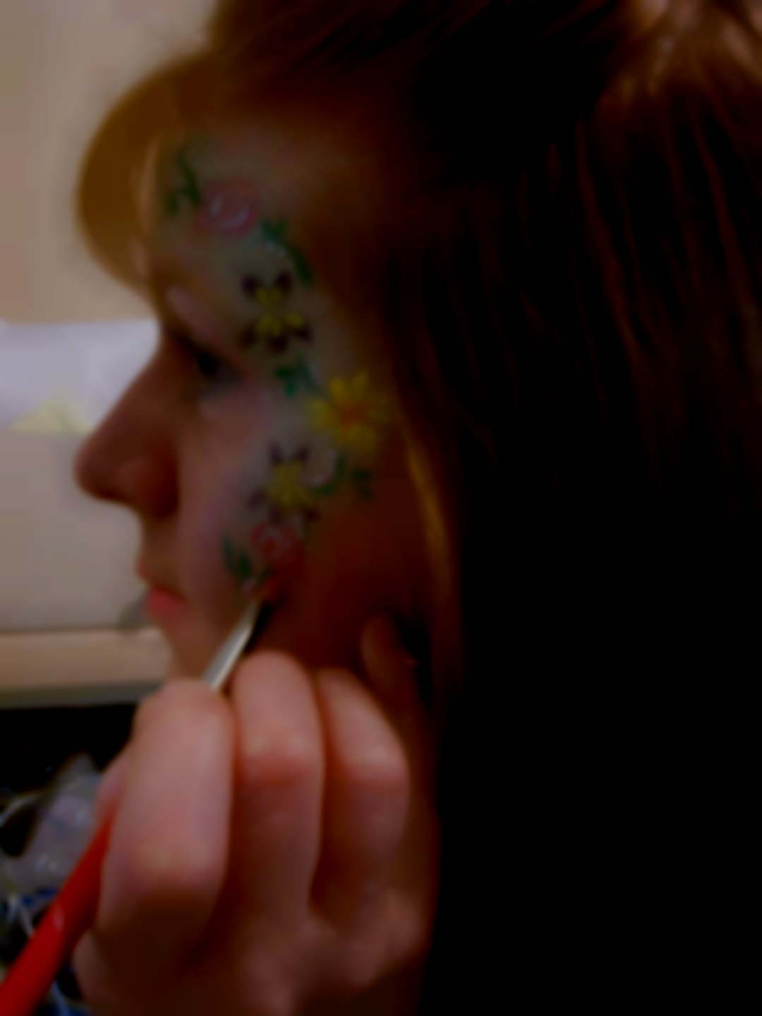 Janet Allen Face Painting her face