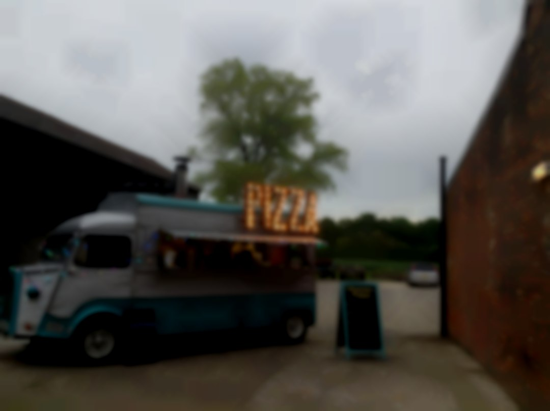 Vintage van providing wood fired pizza for weddings