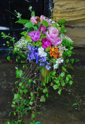 Spring bouquet with bluebells and blossom