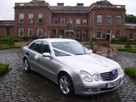 Mercedes-Benz E-Class Wedding Car, in silver.