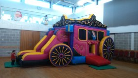 the Princess Carriage bouncy castle and slide