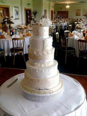 White and gold wedding cake milton keynes