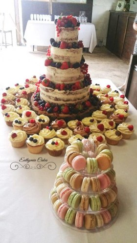 Semi naked wedding cake with fresh fruit and mini french macaron tower