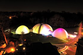 Large inflatable domes, illuminated with connecting tunnels