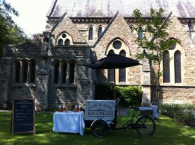 Ice cream tricycle outside a church