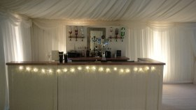 Mobile bar in a wedding marquee