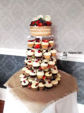 Naked wedding cake and cupcake tower with frensh berries