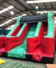 The Bounce Department's 10ft Giant Slide with Dual Ladder available to hire