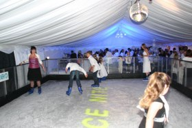 Skaters on a mobile ice rink in one of our marquees