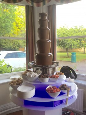 Chocolate fountain with illuminated base