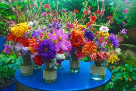 Jazzy jars containing a colourful mix of summer country flowers