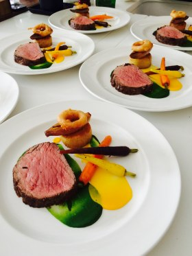 Roast fillet of beef, fondant potato, watercress puree, textures of baby carrots & shallots