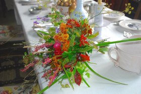 A September wedding bouquet of autumn flowers, berries and grasses