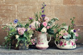 Home grown flowers in china jugs and vintage tins