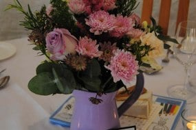country flowers in a water jug