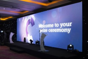 A 10m wide by 3m high 3.9mm pitch LED screen as a stage backdrop for an awards event