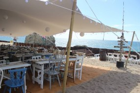 White 10 x 15m stretch tent at a beach wedding