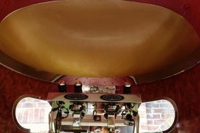 Only the best. Facino Coffee machine, Gold dome & Leather studded ceiling.