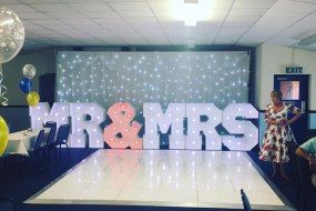 Mr and Mrs Letters along with Backdrop and Dancefloor