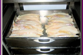 Thick cut cod in our chiller.