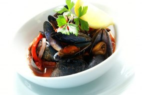Mussels cooked in a spicy African sauce taste of Afica