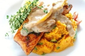 seared salmon atop sweet potato mash peanut sauce