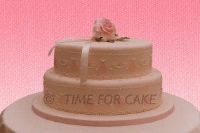 2 tier Oval wedding cake with side design and handmade sugar rose on top