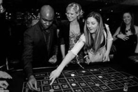 Roulette table and guests placing their bets