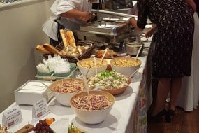 Deli Truck buffet table for 130 guests, 3 hot dishes, 2 hot sides, salads, terrines, pates, cheeses and breads.