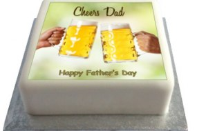 Printed topper of clinking beer glasses on a square cake