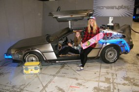 The BTTF Car Delorean Time Machine being used as a photo booth book it now