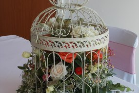 Vintage style birdcage of flowers