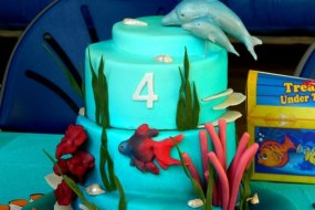 Under the sea 4th birthday cake with dolphins