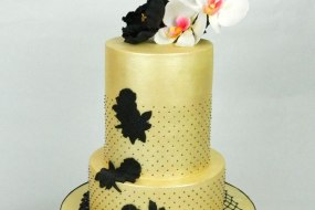 Gold and black wedding cake with sugar flowers