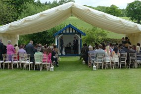 This simple marquee provided cover for the guests in front of a small summer house, so everyone could view the couples ceremony, guests seen here are seated in a theatre style seating