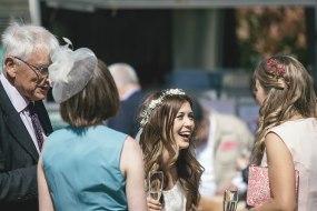 A very happy bride at a country wedding