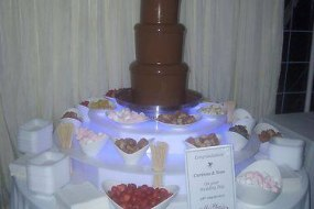 We have a large Chocolate Fountain & two uniformed Chocolatiers
