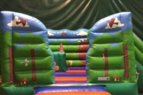 The Bounce Department's Gruffalo Castle with ball pit and Slide available to hire