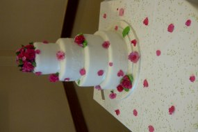 4 tier wedding cake with pink handmade roses and peonies