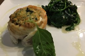 Sea bass fillet wrapped around grated courgette with spinach