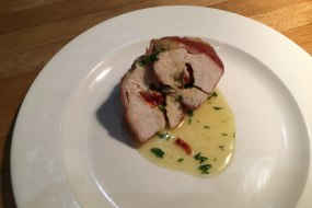 Chicken breast stuffed with sundried tomato and basil and wrapped in Parma ham