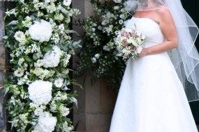Wedding pillar flowers and arrangements