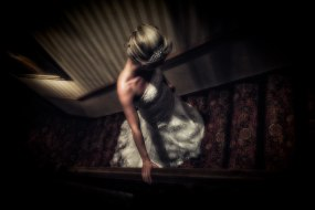 Bride on the stairs of Bunchrew House Hotel.