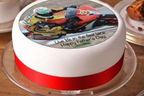 Printed topper of a motorbike racer on a round cake