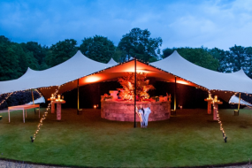 Stretch tent in garden in the evening by intent productions