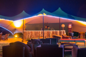 Stretch tent at night by intent productions.